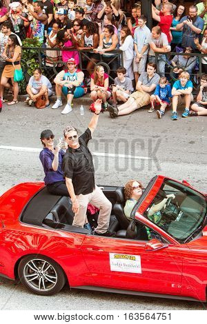 ATLANTA, GA - SEPTEMBER 2016:  Actor Judge Reinhold rides in a convertible and waves to the crowd as he participates in the annual Dragon Con parade in Atlanta GA on September 3 2016.