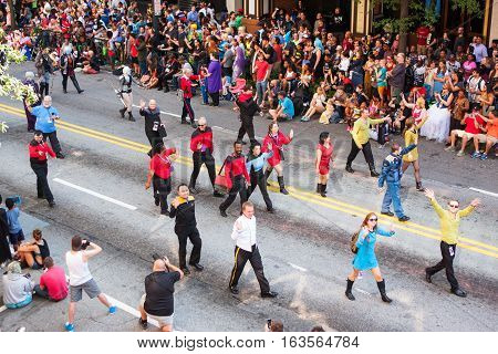 ATLANTA, GA - SEPTEMBER 2016:  People dressed in Star Trek costumes wave to the crowd of spectators as they walk in the annual Dragon Con parade in Atlanta GA on September 3 2016.