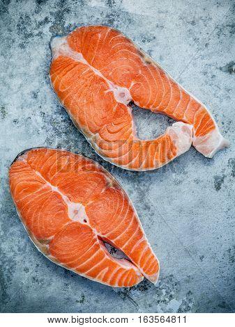 Fresh Salmon Fillet Sliced Flat Lay On Shabby Metal Background. Fresh Salmon Fillet Sliced Tempts Bu