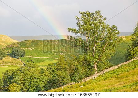 Rainbow landscape near Pooley Bridge, in the Ullswater area of the Lake District in England.
