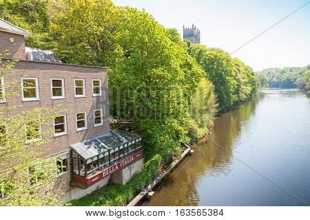 DURHAM UK - MAY 22 2012: Diners in a restaurant overlooking the banks of the River Wear in Durham England.