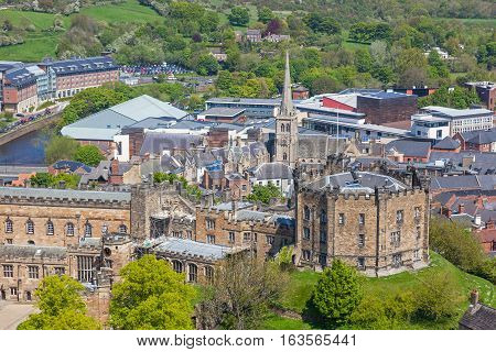 An aerial view of Durham Castle. a Norman castle in the city of Durham, England, which has been wholly occupied since 1840 by University College Durham. The castle and nearby cathedral are a World Heritage Site.