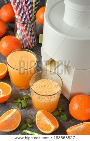 Fresh orange juice on a gray background