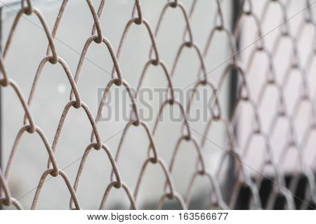 Steel wire mesh on rusty galvanized in Jail Select focus with shallow depth of field.