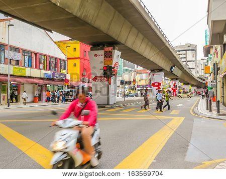 KUALA LUMPUR, MALAYSIA - JANUARY 12, 2014: City traffic in the Chinatown, Kuala Lumpur, Malaysia