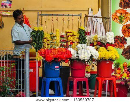 KUALA LUMPUR, MALAYSIA - JANUARY 13, 2014: Vendor of flowers on the street of Chinatown, Kuala Lumpur, Malaysia