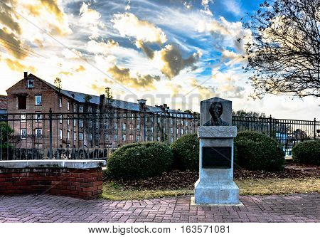 Prattville Alabama USA - December 36 2016: Bust of Daniel Pratt founder of Prattville in Heritage Park overlooking Autauga Creek and Continental Eagle Cotton Gin Company.
