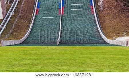 PLANICA, SLOVENIA - NOVEMBER 27, 2016: Close-up of a ski jumping hill at the Planica Nordic Centre, skiing complex with 1 ski flying hill, 7 ski jumping hills and cross-country skiing track.