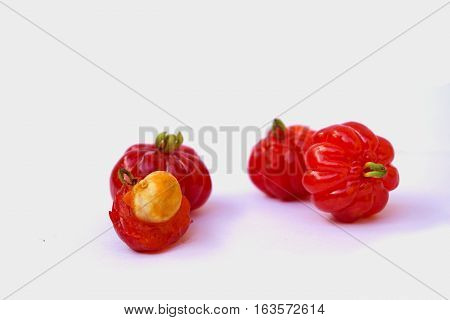 Ripe barbados cherry fruit on white background.