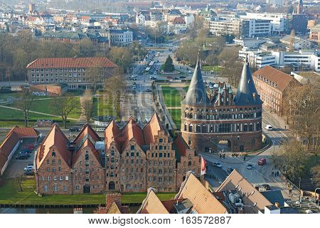 Aerial view of Lübeck in Germany with Holstentor and the Salzspeicher in the foreground