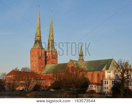 Lübeck Cathedral in warm light with blue skies in the background