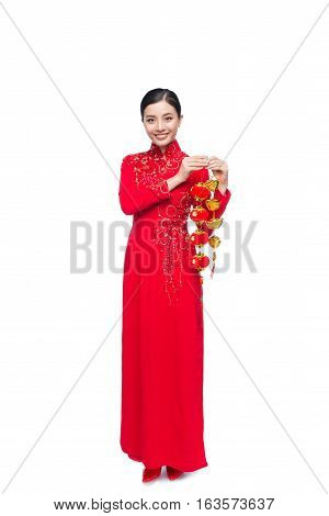 Full Length Of A Beautiful Asian Woman On Traditional Festival Costume Ao Dai. Tet Holiday. Lunar Ne