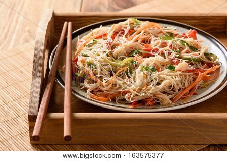 Asian salad with rice noodles and vegetables.