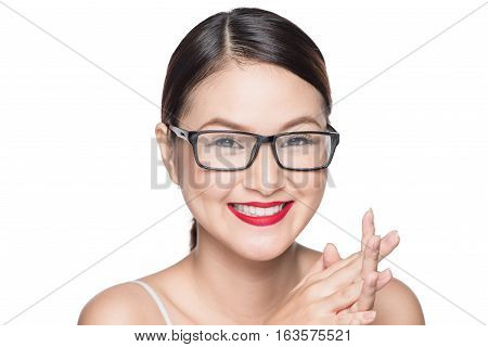 Beauty asian model girl with perfect skin wearing glasses isolated on white background.