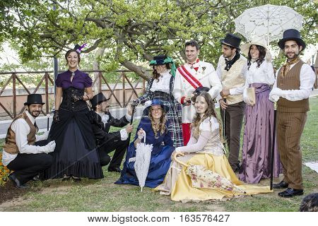 CAGLIARI, ITALY - May 29, 2016: Sunday at La Grande Jatte VIII Ed. At the Public Gardens - Sardinia - group of people in Victorian costumes
