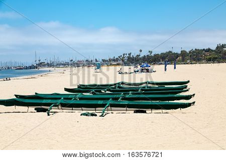 Green Covered Kayaks on Beach in Santa Barbara