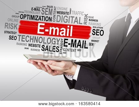 E-mail concept, young man holding a tablet computer.