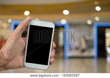Hand Touching Screen of Smartphone shoping with smartphone shoping