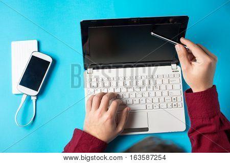 Man Typing On A White Lap Top