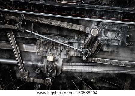 Heaby Stylised Industrialised Grunge Detailed Close Up Of Vintage Steam Train Wheels And Rods And Me