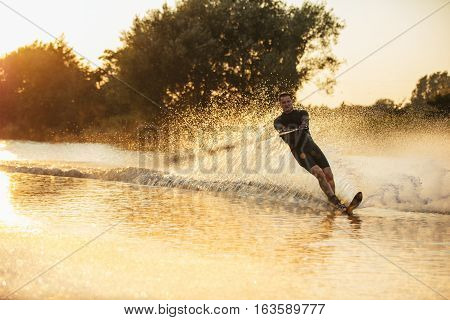 Wakeboarder Surfing Across The Lake