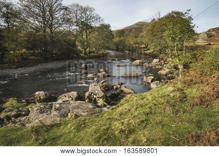 Stunning Autumn Fall Landscape Image Of River Stream In Lake District In England
