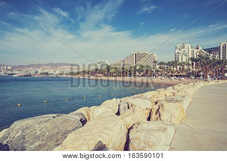 View on the Aqaba gulf from the central beach of Eilat - famous resort and recreational city in Israel
