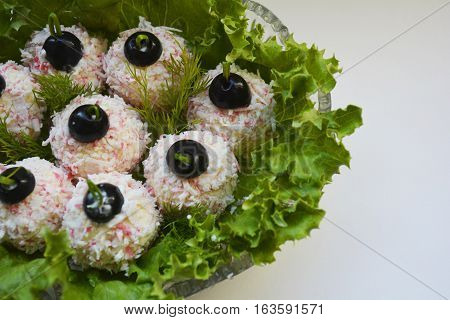 cold holiday appetizer cheese balls on lettuce leaves