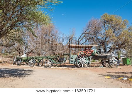 KOFFIEFONTEIN SOUTH AFRICA - DECEMBER 24 2016: An historic old steam tractor and wagons in Koffiefontein a diamond mining town in the Free State Province