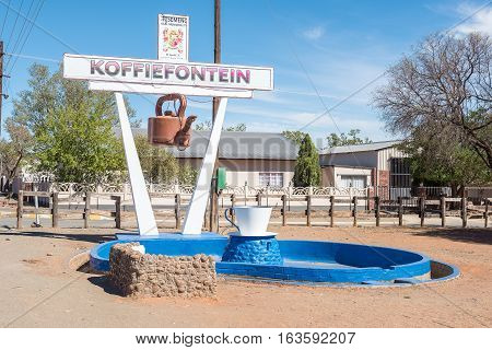 KOFFIEFONTEIN SOUTH AFRICA - DECEMBER 24 2016: A coffee kettle and a cup display in Koffiefontein (coffee fountain) a diamond mining town in the Free State Province