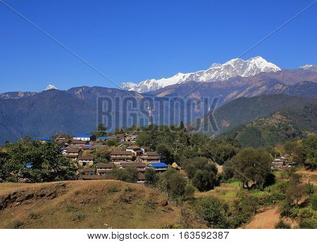 Ghale Gaun Gurung village on a hill top in the Annapurna Conservation Area. Snow capped Annapurna range.