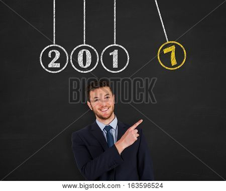 New Year Newtons Cradle on Blackboard Background