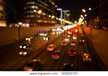 Cars driving on road at night, blurred photo
