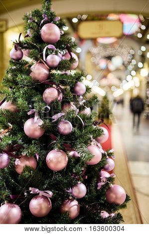 Christmas tree decorated with pink balls in trading hall