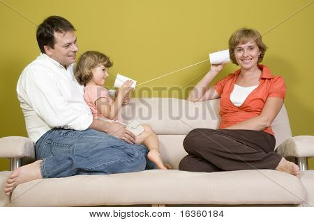 Family playing with mug phone