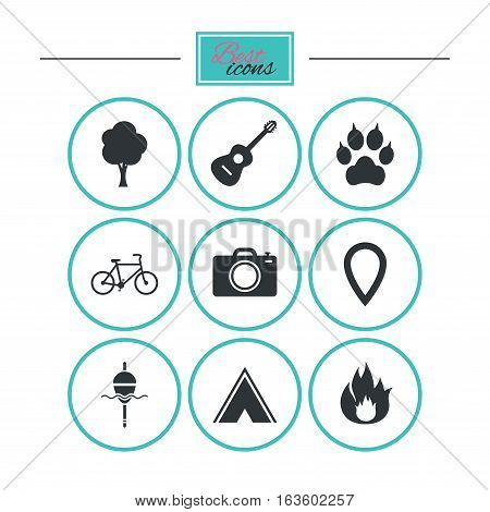 Tourism, camping icons. Fishing, fire and bike signs. Guitar music, photo camera and paw with clutches. Round flat buttons with icons. Vector