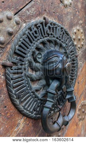 Lion Head Door Knocker Ancient Knocker bronze handles on old oak stock photo
