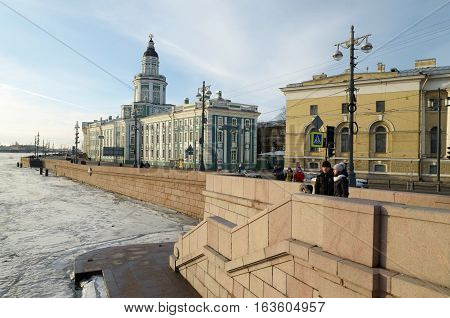 01.01.2017.Russia.Saint-Petersburg.The granite embankment along the riverwhich is icebound.