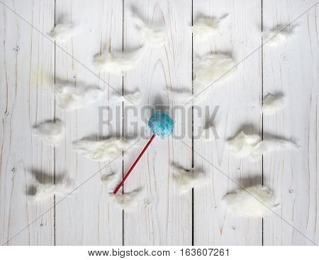 Blue cakepops among the candy-floss clouds, white background