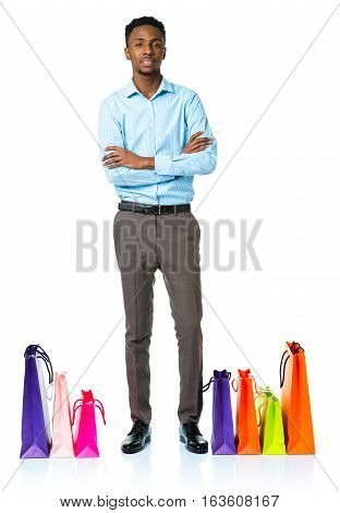 Happy african american man with shopping bags on white background. Christmas and holidays concept
