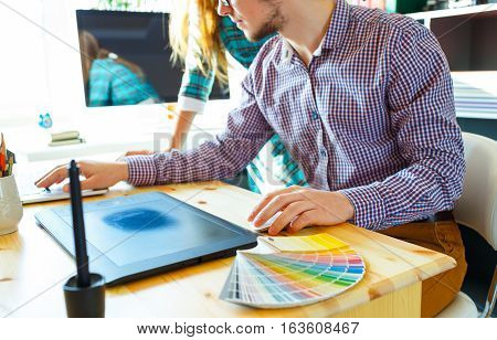 Successful young woman and man working from home - modern business concept