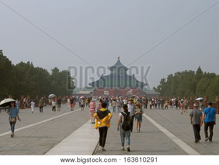 Tiananmen Square in Beijing. Beijing, China - June 08, 2016 Beijing Residents and tourists in front of the Great gate on Tiananmen Square in Beijing.