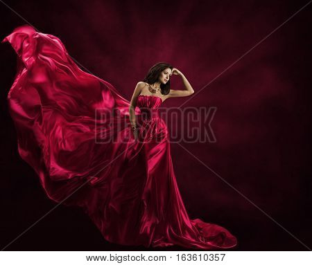 Fashion Model Dress Woman in Flying Gown Silk Fabric Waving on Wind Satin Cloth Flowing Waves