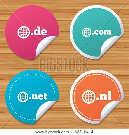 Round stickers or website banners. Top-level internet domain icons. De, Com, Net and Nl symbols with globe. Unique national DNS names. Circle badges with bended corner. Vector