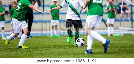 Young Boys Playing Soccer Football Match on Pitch. Kids Running and Kicking Soccer Ball on Green Grass. Soccer Children Game