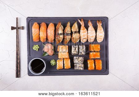Set sushi and soy sauce on a marble table