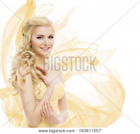 Woman Beauty Fashion Model Portrait Blond Hair Long Curls Yellow Waving Fabric over white