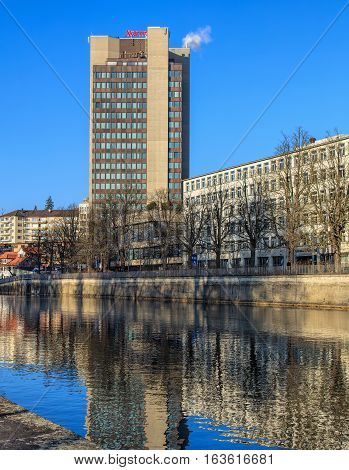 Zurich, Switzerland - 1 January, 2017: the Hotel Marriott building, the Limmat river in the foreground. Marriott Hotels & Resorts is the brand of full-service hotels and resorts of the Marriott International's company, based in Washington D.C.