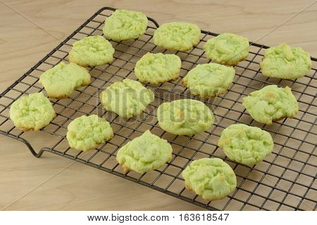 Key lime sugar cookies on cooling rack on wooden table