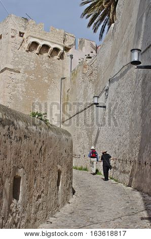 Tourists Walking Up The Steep Path To San Domino